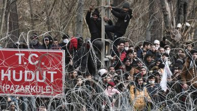 This picture taken from the Greek side of the Greece-Turkey border near Kastanies, shows migrants waiting on the Turkish side on March 2, 2020. - Greece was on a state of alert on March 1, 2020 as it faced an influx of thousands of migrants seeking to cross the border from Turkey, with locals fearing a new immigration crisis. More than 13,000 migrants have gathered on the Turkish side of the river which runs 200 kilometres (125 miles) along the frontier and separates them from Greece and therefore the European Union. The flow of migrants from Turkey has triggered EU fears of a re-run of the 2015 migrant emergency when Greece became the main EU entry point for a million migrants, most of them refugees fleeing the Syrian civil war. (Photo by Sakis MITROLIDIS / AFP) (Photo by SAKIS MITROLIDIS/AFP via Getty Images)